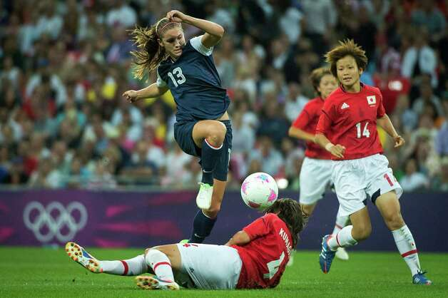 United States' Alex Morgan (13) leaps over Japan's Saki Kumagai during the women's soccer gold medal match at the 2012 London Olympics on Thursday, Aug. 9, 2012. The USA won the game 2-1 to claim the gold medal. Photo: Smiley N. Pool, Houston Chronicle / © 2012  Houston Chronicle