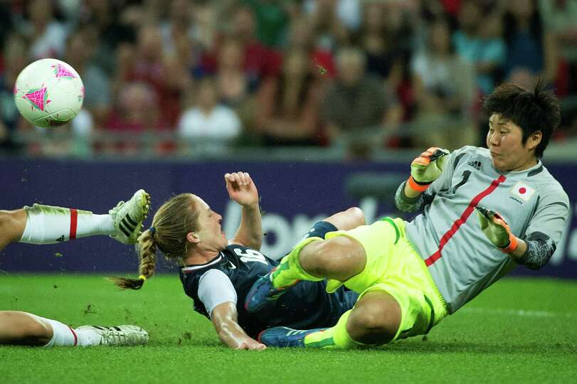 Japan goalkeeper Miho Fukumoto makes a stop on the United States' Rachel Buehler during the women's