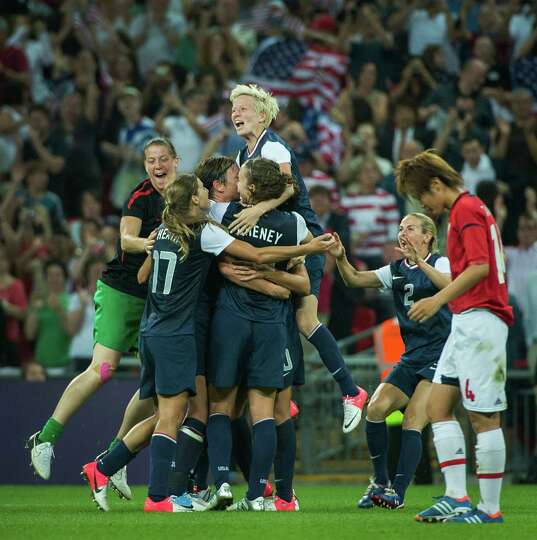 US players mob Carli Lloyd in celebration after the women's soccer gold medal match at the 2012 Lond