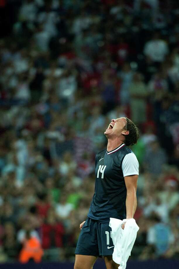 Abby Wambach of the United States lets out a scream in celebration of a victory over Japan in the women's soccer gold medal match at the 2012 London Olympics on Thursday, Aug. 9, 2012. The USA won the game 2-1 to claim the gold medal. Photo: Smiley N. Pool, Houston Chronicle / © 2012  Houston Chronicle