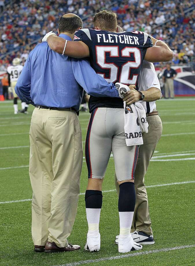 FOXBORO, MA - AUGUST 9:   Dane Fletcher #52 of the New England Patriots is taken from the field by medical staff after he injured his knee in the first half against the New Orleans Saints at Gillette Stadium on August 9, 2012 in Foxboro, Massachusetts. (Photo by Jim Rogash/Getty Images) Photo: Jim Rogash / 2012 Getty Images
