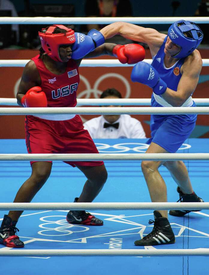 Claressa Shields of the USA fights Nadezda Torlopova of Russia for the women's middle weight 75kg boxing gold medal at the 2012 London Olympics on Thursday, Aug. 9, 2012. Shields won the bout for the first USA gold medal in women's boxing. Photo: Smiley N. Pool, Houston Chronicle / © 2012  Houston Chronicle