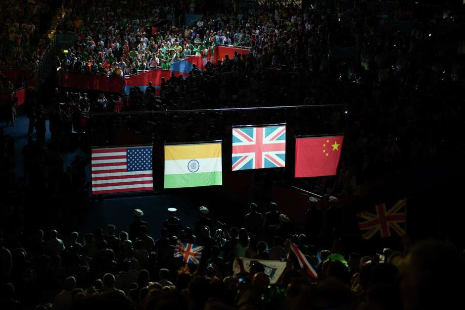 The flags of the USA, India, Great Britain and China are raised during the awards ceremony for women's semifinal flyweight 51-kg boxing at the 2012 London Olympics on Thursday, Aug. 9, 2012. Nicola Adams of Great Britain took gold. Cancan Ren of China took silver. Marlen Esparza of the USA and Chungneijang Mery Kom Hmangte of India took bronze in the event. Photo: Smiley N. Pool, Houston Chronicle / © 2012  Houston Chronicle