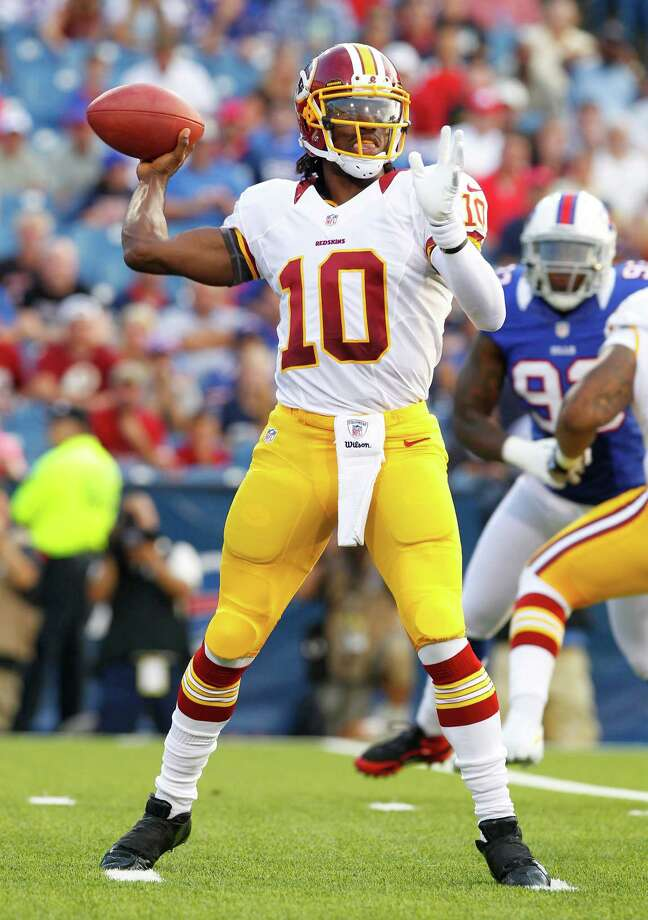 Washington Redskins quarterback Robert Griffin III throws during the first half of a preseason NFL football game against the Buffalo Bills in Orchard Park, N.Y., Thursday, Aug. 9, 2012. (AP Photo/Bill Wippert) Photo: Bill Wippert