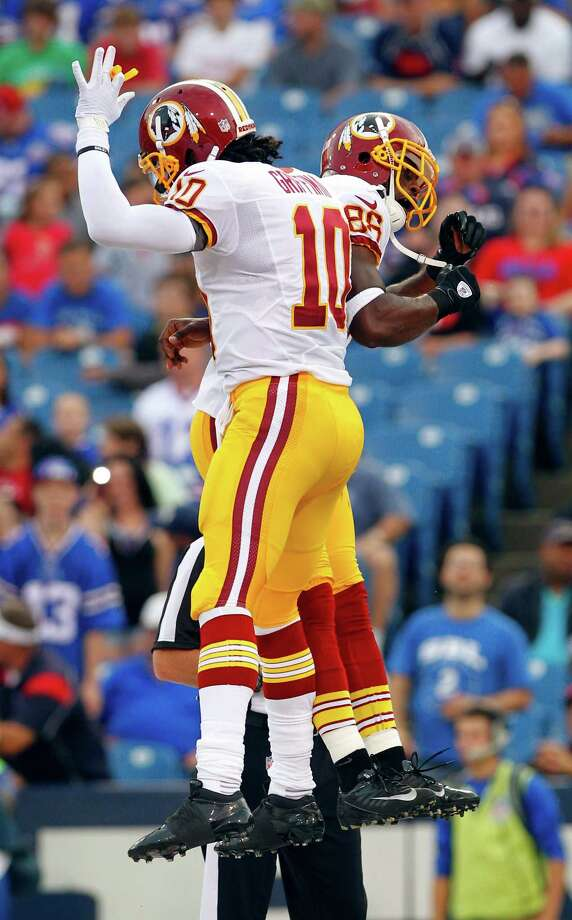 Washington's Robert Griffin III and Pierre Garcon (88) celebrate after connecting on a 20-yard scoring pass. Photo: Bill Wippert / FR170745 AP