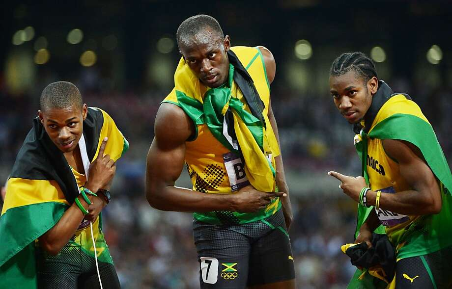 TOPSHOTS Jamaica's Usain Bolt (C) celebrates with Jamaica's Yohan Blake (R) and Jamaica's Warren Weir (L) after winning the men's 200m final at the athletics event during the London 2012 Olympic Games on August 9, 2012 in London.    AFP PHOTO / OLIVIER MORINOLIVIER MORIN/AFP/GettyImages Photo: Olivier Morin, AFP/Getty Images