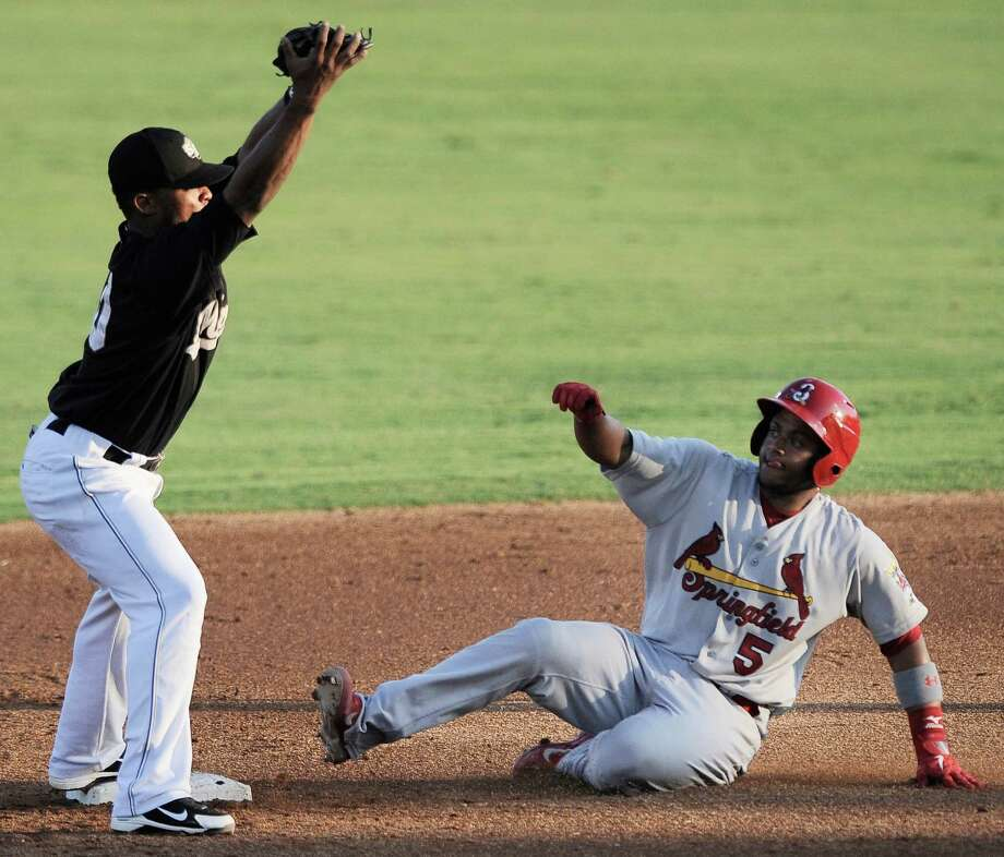 San Antonio Missions' Jeudy Valdez, left, tags Springfield Cardinals' Audry Perez out at second base during a Texas League baseball game, Thursday, Aug. 9, 2012, in San Antonio. Photo: Darren Abate, For The Express-News