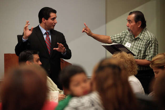 City Councilman David Medina tries to get Raymond Zavala to only discuss the three points that his group came up with after concerned residents and business owners had a breakout session to discuss problems in the neighborhood surrounding Haven for Hope during a community meeting with Medina at Haven for Hope on Thursday, August 9, 2012. Photo: Lisa Krantz, San Antonio Express-News / San Antonio Express-News