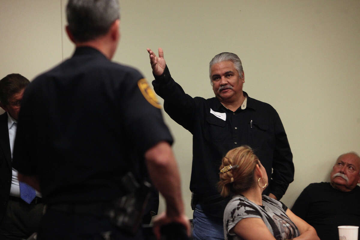 Abel Ruiz, right, complains to San Antonio Police Department Chief William McManus, left, about the timing of the meeting because many people from his church, La Luz Del Mundo, were in Mexico and could not attend the meeting, during the community meeting with City Councilman David Medina at Haven for Hope on Thursday, August 9, 2012.