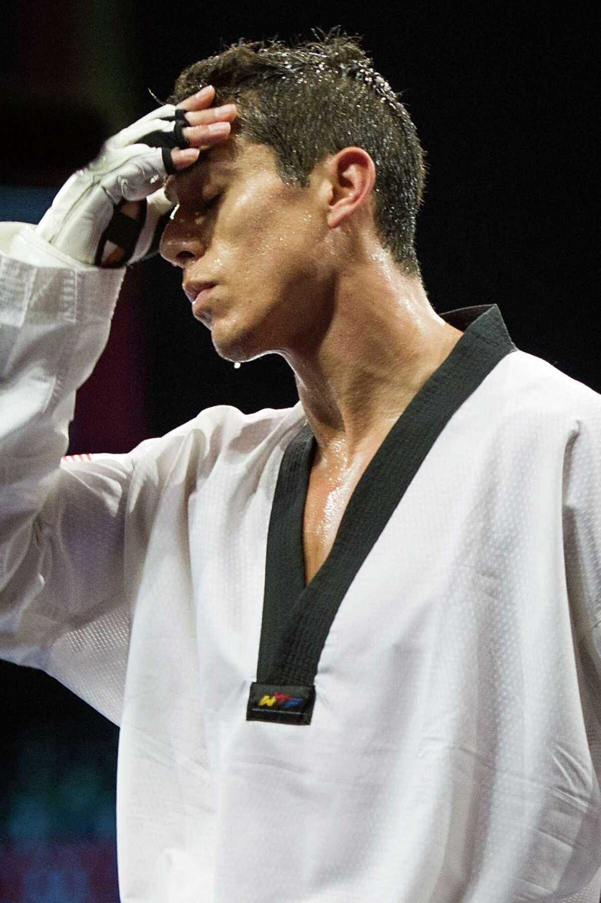 Steven Lopez of the USA reacts as he walks out of the arena after losing to Azerbaijan's Ramin Azizov in the men's 80-kg taekwondo competition at the 2012 London Olympics on Friday, Aug. 10, 2012.