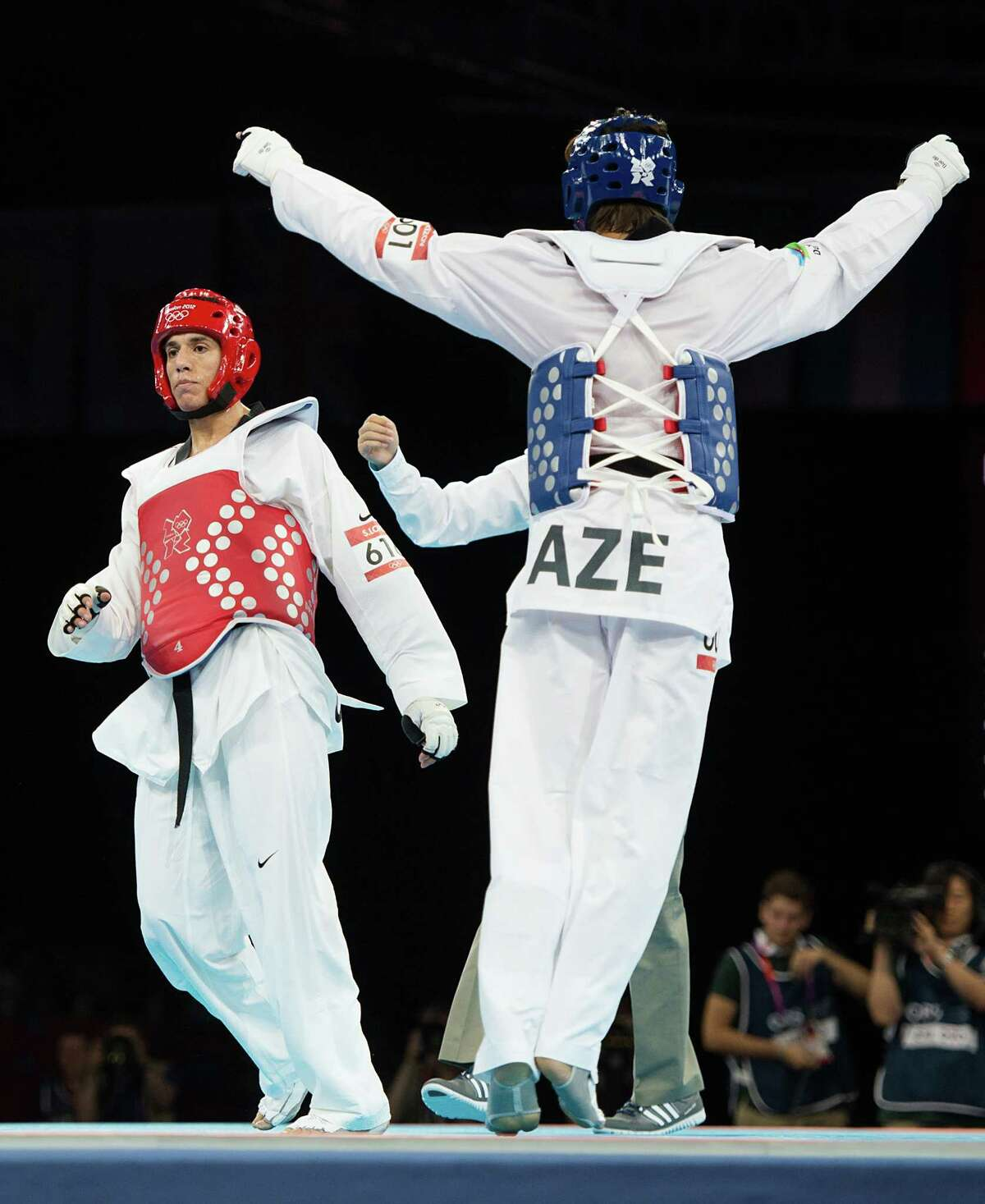 Azerbaijan's Ramin Azizov celebrate his victory over Steven Lopez of the USA, left, in the men's 80-kg taekwondo competition at the 2012 London Olympics on Friday, Aug. 10, 2012.