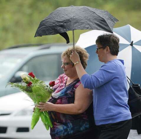 Friends of the deceased and parishioners arrive August 10, 2012 for a special mass at St. Mathew's Roman Catholic Church where three women were killed a year to the day ago in Voorheesville, N.Y.        (Skip Dickstein/Times Union) Photo: Skip Dickstein / 00018720A