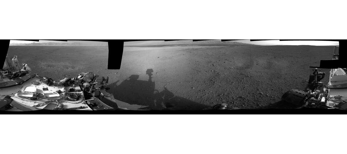 This NASA handout image released August 9, 2012 shows a 360-degree, full-resolution panorama from NASA's Curiosity rover revealing the area all around the rover within Gale Crater on Mars. The rover's deck is to the left and far right. The rover's