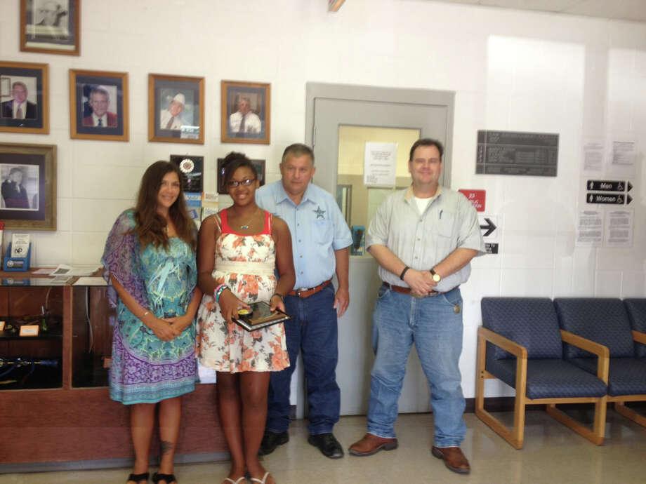 Michelle LaLonda, Symone LaLonde, Sheriff Mitchel Newman and Jasper County Judge/DETCOG President Mark Allen Photo: Jodie Warner