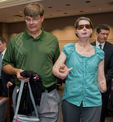 Charla Nash arrives with her brother Stephen, left, for a hearing at the Legislative Office Building in Hartford, Conn., Friday, Aug. 10, 2012.  Nash who was mauled in a 2009 chimpanzee attack is attending a hearing to determine whether she may sue the state for $150 million in claimed damages. Photo: Jessica Hill, Jessica Hill/Associated Press / Associated Press