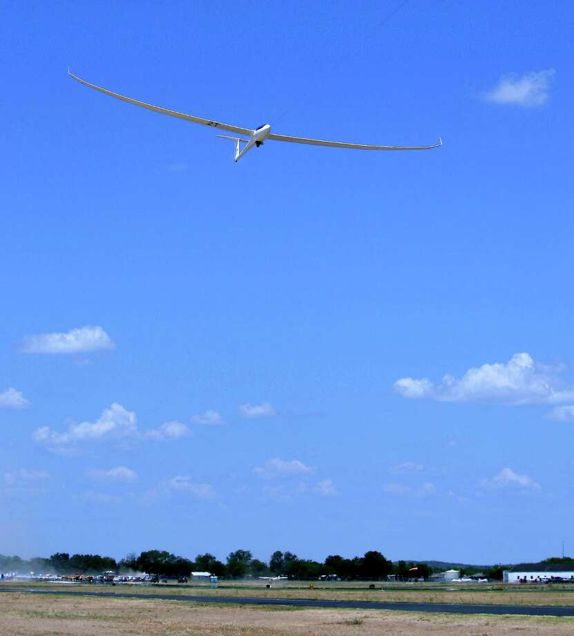 An open-class glider takes off Wednesday Aug. 8, 2012 from Garner Field airport in Uvalde at the start of Day 4 competition at the 32nd FAI World Gliding Championship. Photo: William Luther, San Antonio Express-News / © 2012 San Antonio Express-News