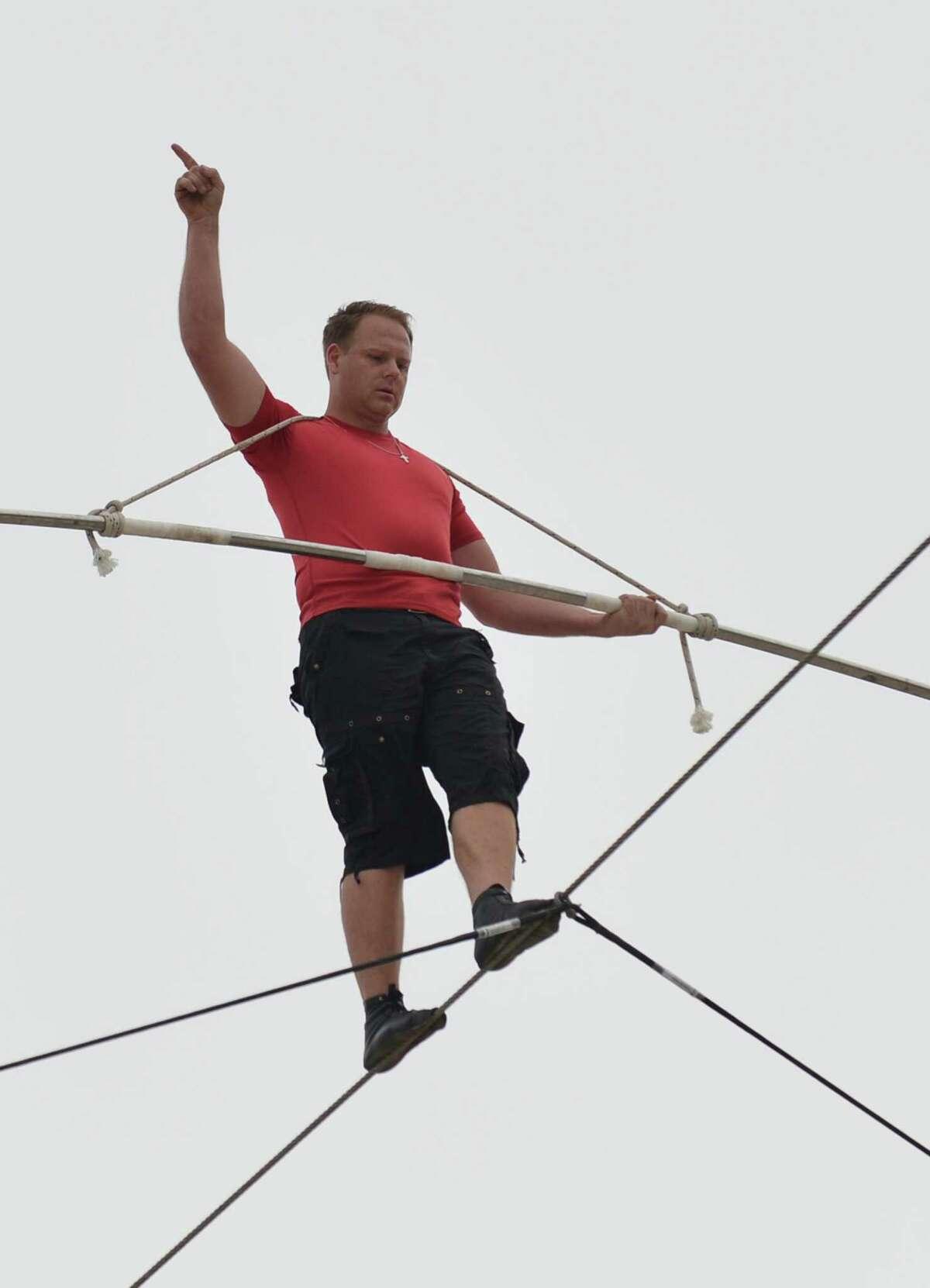 Daredevil Nik Wallenda during his 1,500-foot (457 meters) tightrope walk 100 feet (30.5 meters) above the beach August 9, 2012 in Atlantic City, New Jersey. AFP PHOTO/Stan HONDASTAN HONDA/AFP/GettyImages