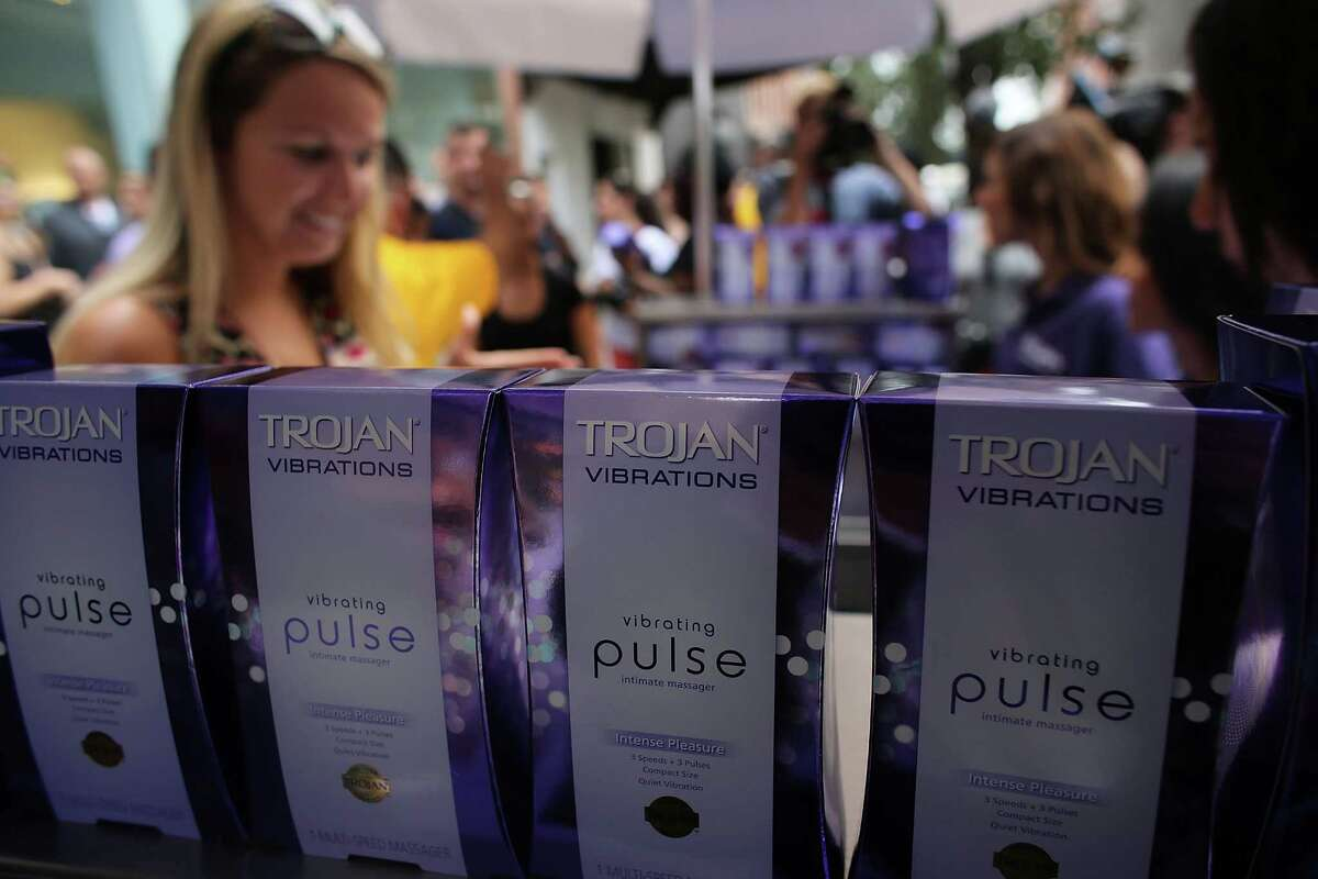 NEW YORK, NY - AUGUST 09: People receive a free vibrator sex toy which was being distributed by the Trojan condom company from their