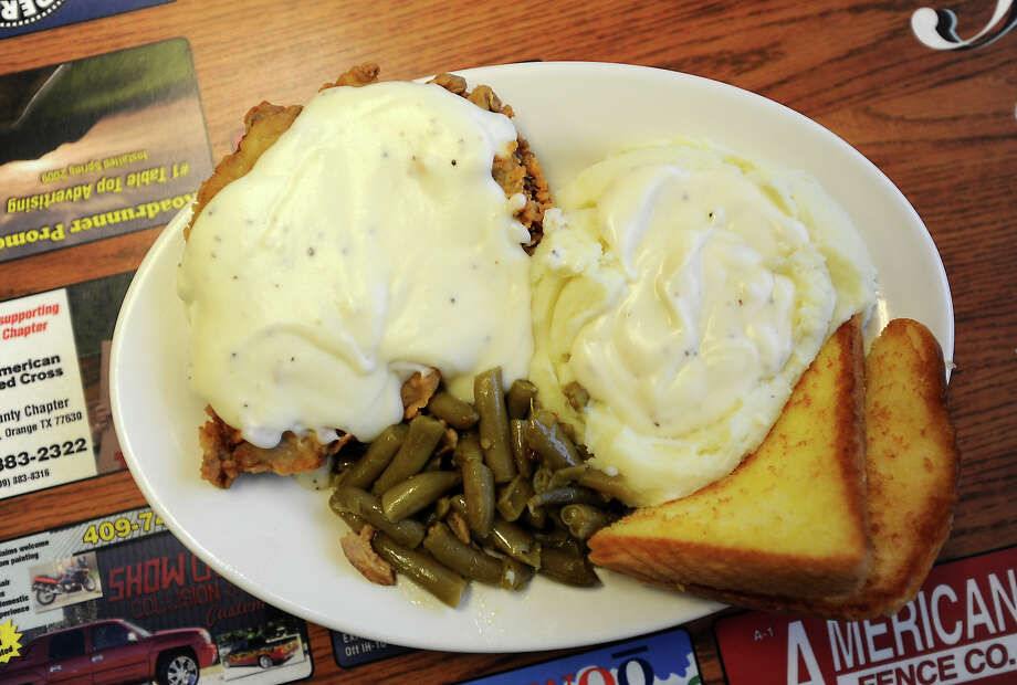 Gary's Cafe in Orange serves up chicken fried steak and mashed potatoes smothered in gravy, green beans and texas toast. Tammy McKinley/The Enterprise Photo: TAMMY MCKINLEY
