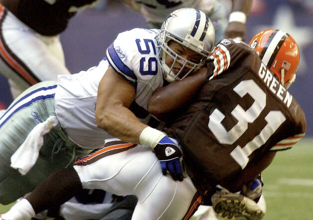 Cowboys LB Dat Nguyen stops Cleveland RB William Green Sunday, September 19, 2004. GLORIA FERNIZ/STAFF Photo: GLORIA FERNIZ, SAN ANTONIO EXPRESS-NEWS