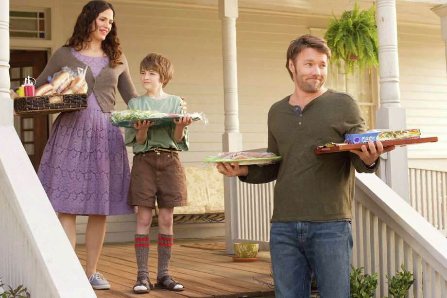 """""""THE ODD LIFE OF TIMOTHY GREEN""""  Cindy (Jennifer Garner, left), Timothy (CJ Adams, center) and Jim Green (Joel Edgerton, right) welcome their family to a picnic so that they can introduce Timothy to the clan.  Ph: Phil Bray  Disney Enterprises, Inc. All Rights Reserved. Photo: Phil Bray / ©Disney Enterprises, Inc. All Rights Reserved."""