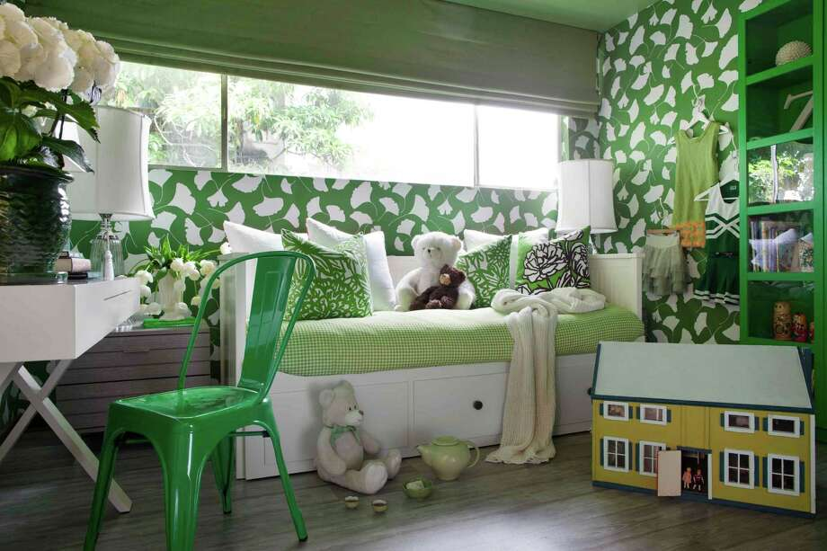 In this image provided by Brian Patrick Flynn, the bedroom of a tween cheerleader, designed by Brian Patrick Flynn, shows his use of the kelly green fabric of her cheerleading camp uniform as inspiration in Los Angeles. The green-covered space not only reminds her of cheerleading, but also wide open, green spaces. (AP Photo/Brian Patrick Flynn, Sarah Dorio/HGTV Remodels) Photo: Sarah Dorio/HGTV Remodels / Brian Patrick Flynn