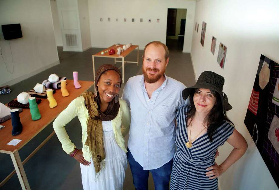 Artists Nsenga Knight, left, Nick Barbee, center, Kelly Sears, right, stand in the Galveston Arts Center Monday, July 16, 2012, in Galveston. (Cody Duty / Houston Chronicle) Photo: Cody Duty / © 2011 Houston Chronicle