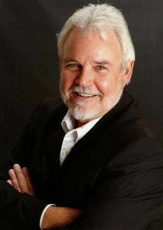 I have been told many times that I look like Kenny Rogers. Once in Las Vegas, my wife and I were walking out of a casino and some people stopped me and asked for a photo. My wife said he s not who you think he is. They insisted so we took some pictures. The next night my wife and I were at a company-sponsored function, in a big ball room and one of the wait staff told me she had seen me on the big screen last night. I get this too, usually the Gambler movie. I said, did you see the Gambler last night, no, she said she saw me here, in this ball room, on the big screen. I didn t understand what she was telling me. She said she was working a corporate function the night before and my picture was on the big screen. She said a company had a celebrity scavenger hunt in Las Vegas, where teams had to go out and find a celeb or a look alike and get a picture with them. She said my team won. I had a good chuckle about that one. I think lots of guys look like Kenny Rogers. -- Tim Thompson Photo: Handout, Tim Thompson, Reader Submission