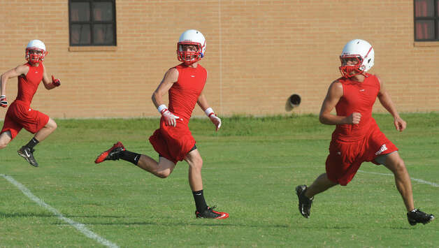 Bridge City players met on the school's practice field Wednesday to drill plays and ready the team for their match up with the Eagles in Newton on August 31. Photo taken Wednesday, August 8, 2012 Guiseppe Barranco/The Enterprise Photo: Guiseppe Barranco, STAFF PHOTOGRAPHER / The Beaumont Enterprise