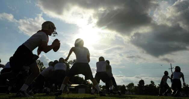 Hamshire-Fannett held one of their football practices Wednesday night, August 8, 2012 and started at 6 p.m.   Dave Ryan/The Enterprise Photo: Dave Ryan