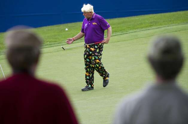 People watch John Daly on No. 17 during the Canadian Open golf tournament pro-am at Hamilton Golf and County Club in Ancaster, Ontario, Wednesday, July 25, 2012. (Nathan Denette / Associated Press)