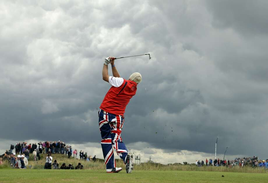 John Daly of the United States plays a shot off the fifth tee at Royal Lytham & St Annes golf club during the second round of the British Open Golf Championship, Lytham St Annes, England, Friday, July 20, 2012.  (Chris Carlson / Associated Press)