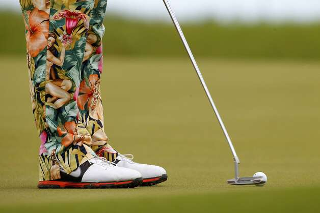 John Daly putts during a practice round for the PGA Championship golf tournament on the Ocean Course of the Kiawah Island Golf Club in Kiawah Island, S.C., Tuesday, Aug. 7, 2012.  (Chuch Burton / Associated Press)