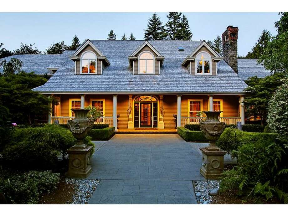 Here's a recently erected take on an opulent European-style country manor: 416 289th Place N.E., in Carnation. The 8,522-square-foot house, built in 1997, has five bedrooms, four full bathrooms, two powder rooms, a two-story living room with a floor-to-ceiling stone fireplace, huge chandeliers, marble floors, a theater, a wood-paneled study, French doors, a hot tub and sauna, a wine cellar and a pool with a fountain on a 1.2-acre lot. It's listed for $2.3 million. Photo: Courtesy Realogics Sotheby's International Realty