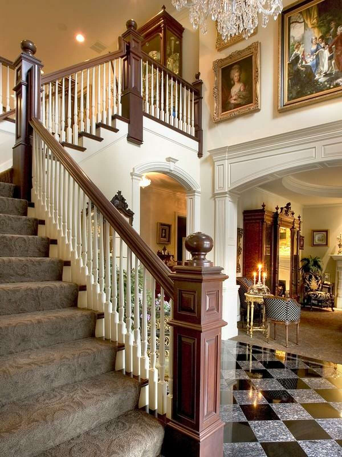 Foyer of 416 289th Place N.E., in Carnation. The 8,522-square-foot house, built in 1997, has five bedrooms, four full bathrooms, two powder rooms, a two-story living room with a floor-to-ceiling stone fireplace, huge chandeliers, marble floors, a theater, a wood-paneled study, French doors, a hot tub and sauna, a wine cellar and a pool with a fountain on a 1.2-acre lot. It's listed for $2.3 million.