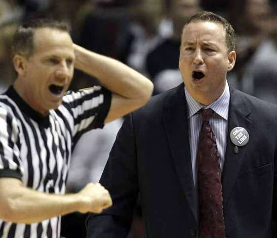 Texas A&M coach Billy Kennedy, right, reacts to a foul call against his team during the second half of an NCAA college basketball game against the Missouri Saturday, Feb. 18, 2012, in College Station, Texas. Missouri beat Texas A&M 71-62. (AP Photo/David J. Phillip) (AP)