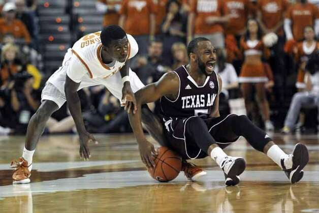 Texas A&M guard Dash Harris, right, fights for a loose ball with Texas guard Myck Kabongo during the first half of an NCAA college basketball game Wednesday, Jan. 11, 2012, in Austin, Texas. (AP Photo/Michael Thomas)