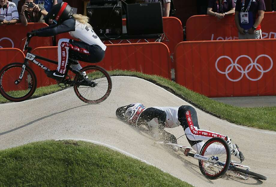 United States' Brooke Crain (32) passes Alise Post, also of the U.S., who crashed in a BMX cycling women's semifinal run during the 2012 Summer Olympics in London, Friday, Aug. 10, 2012. (AP Photo/Christophe Ena) Photo: Christophe Ena, Associated Press