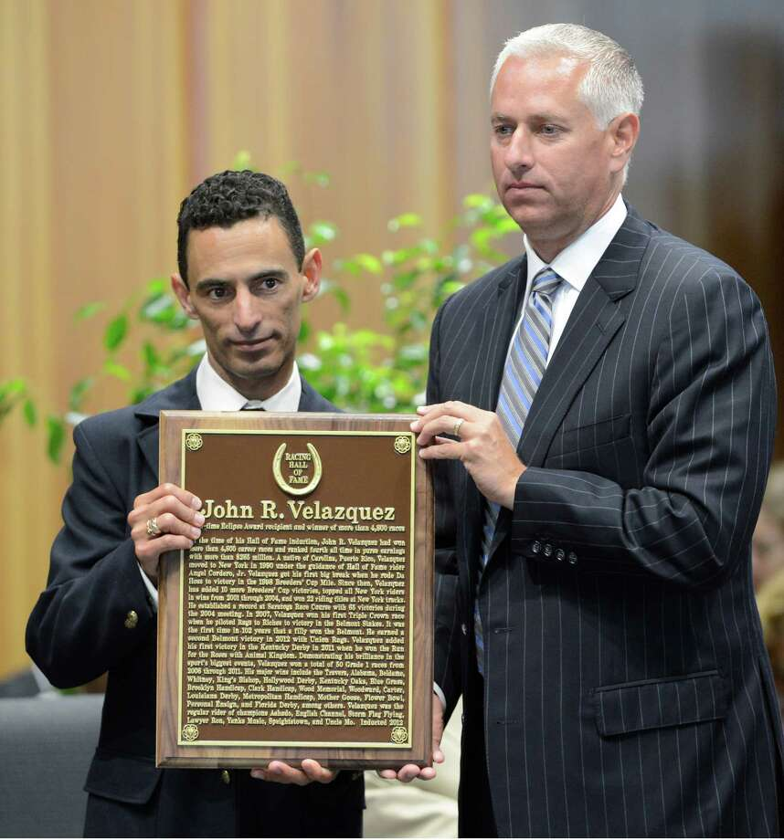 Jockey Johnny Velazquez, left stands with trainer Todd Pletcher as he accepts his induction in to Thoroughbred Racing's Hall of Fame at the National Racing Museum and Hall of Fame inductions held at the Fasig Tipton Sales arena in Saratoga Springs, N.Y. Aug 10, 2012.      (Skip Dickstein/Times Union) Photo: Skip Dickstein