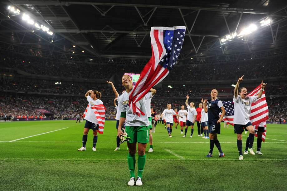 Hope Solo, No. 1, of the United States celebrates with the American flag after defeating Japan by a score of 2-1 to win the Women's soccer gold medal at the London 2012 Olympic Games on Thursday in London. (Michael Regan / Getty Images)