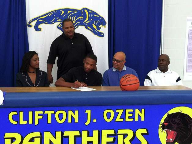 Ozen boys basketball player Earnest Maize signed with Temple Junior College on Friday, Aug. 10, 2012. Photo: Jared Ainsworth