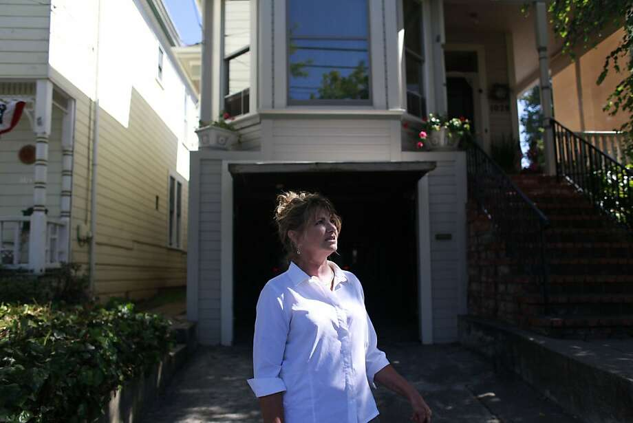 Candy Dewitt, mother of Daniel Dewitt, comes home after walking her dog on July 6, 2012 in Alameda, Calif. Daniel Dewitt, 23, a consumer of the mental health system, killed a man in the Oakland Hills after schizophrenic delusions got the best of him last February. Photo: Mike Kepka, The Chronicle