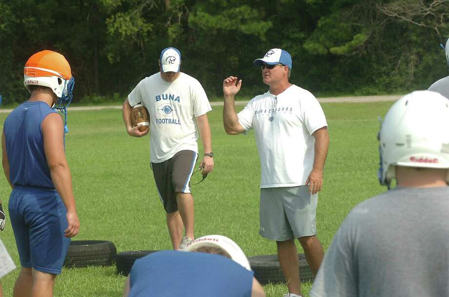 Head coach Bradley Morgan works with the Buna Cougars on Tuesday, Aug. 7 in Buna. Photo: David Henry