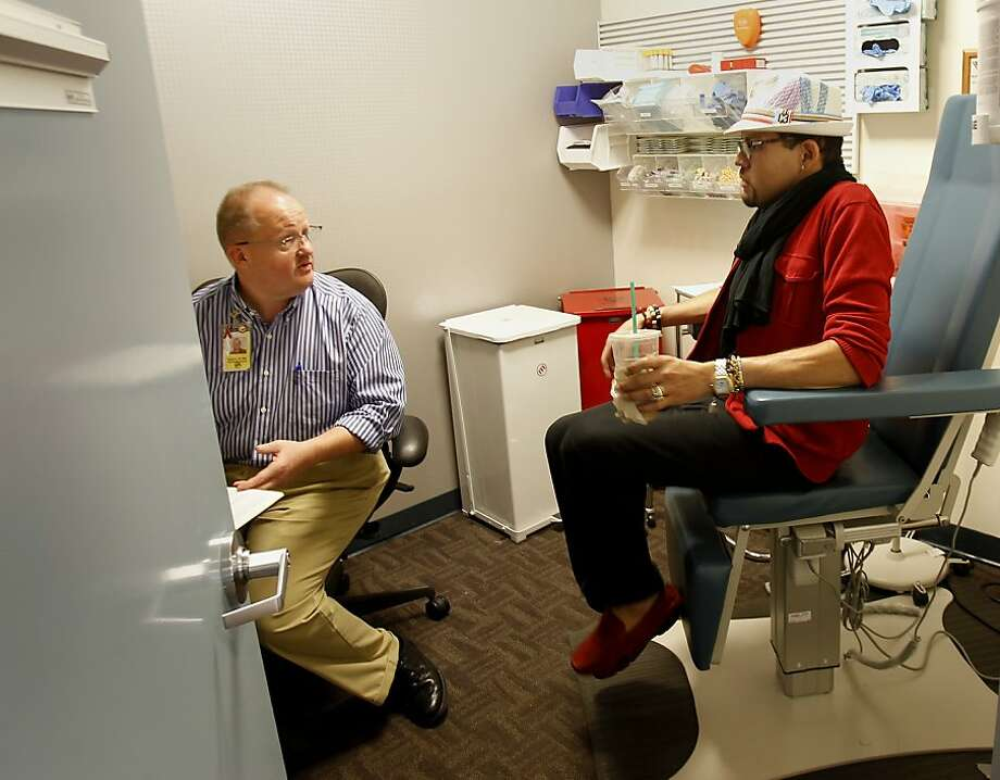 Nurse Tim Ryan (left) talks with Eloy Garcia before drawing blood. At the Magnet Health Center in San Francisco, Calif. lines sometimes form for HIV testing and people make appointments throughout the day. Photo: Brant Ward, The Chronicle