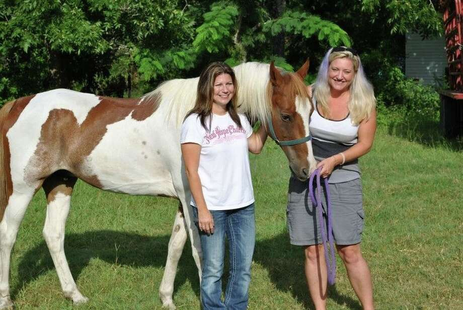 Deanna Bordelon, left, with Opie, and his original owner, Michelle Pool. Photo: Stolen Horse International