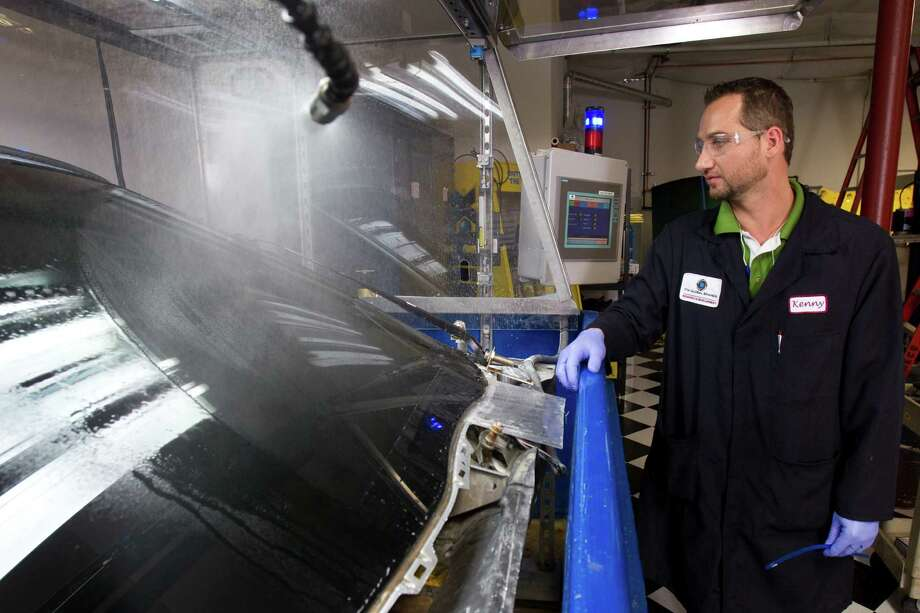 Kenny Teal, senior R&D associate, tests wiper blades at ITW Global Brands Wednesday, July 11, 2012, in Houston. ITW makes innovative products for automobile appearance and performance. Photo: Brett Coomer, Houston Chronicle / © 2012 Houston Chronicle