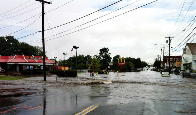 Haevy rains caused flooding on Barnum Avenue in Stratford Conn. on Friday, August 10, 2012. Photo: Keila Torres Ocasio / Connecticut Post