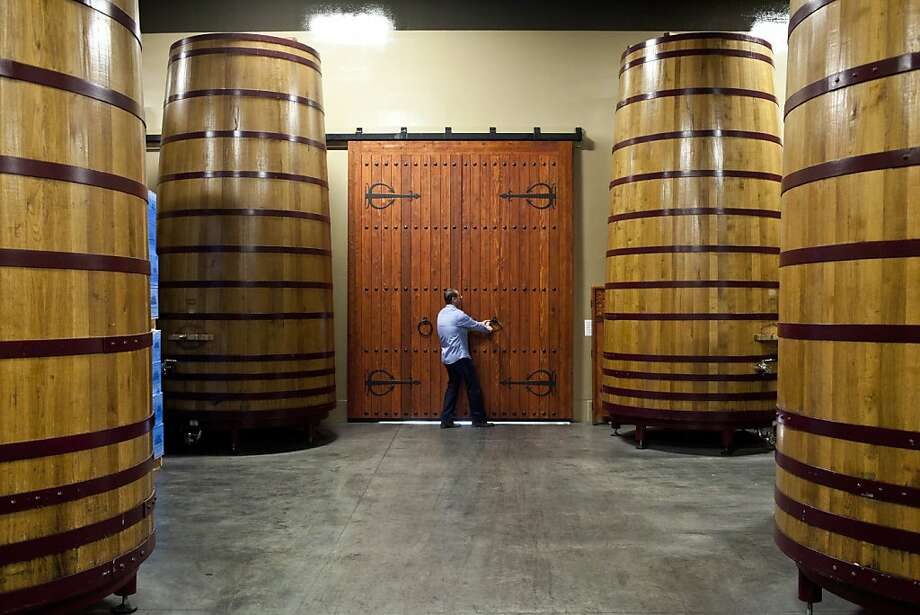John Concannon opens the door in the barrel room at his family's vineyard in Livermore. The Wine Group bought the winery in 2002, but he runs the day-to-day. Photo: Jason Henry, Special To The Chronicle