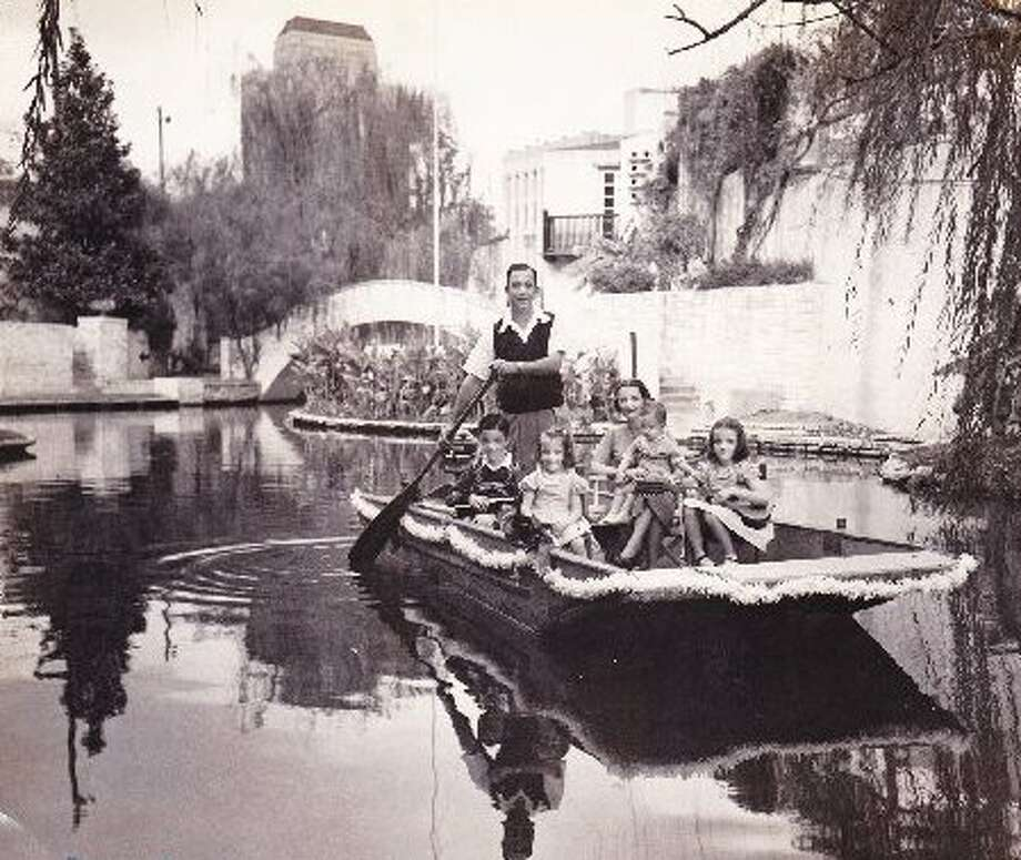 Laurence and Mary Margaret Wingerter pose on a river boat for a Christmas-card photo with their children Laurence Jr., Melinda, baby Nicholas and Diane. Photo: Courtesy Melinda Wingerter Keena