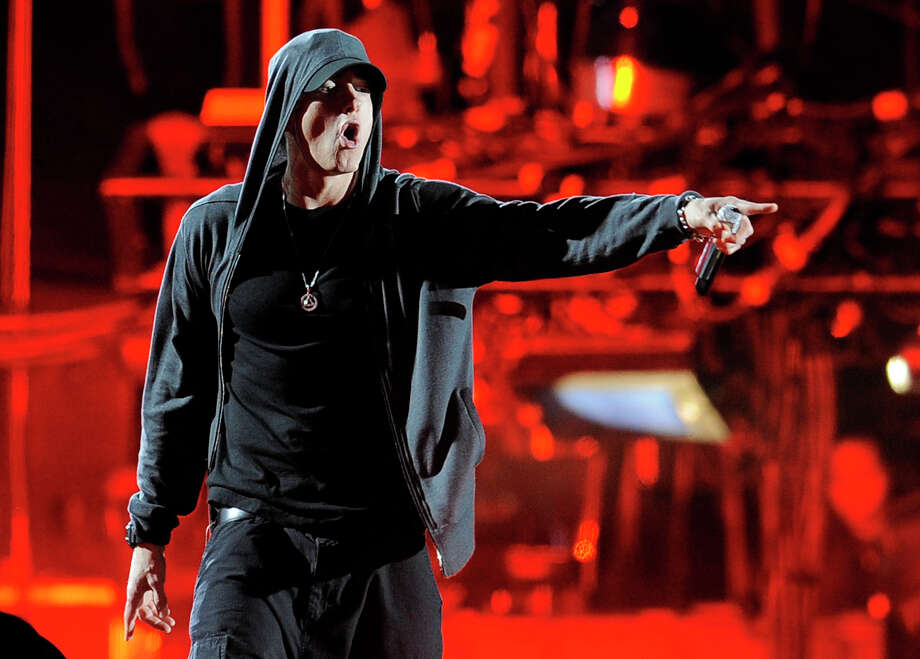 FILE -- In an April 15, 2012 photo Eminem performs onstage at the 2012 Coachella Valley Music and Arts Festival in Indio, Calif.   Eminem, who battled an addiction to prescription drugs, thanked his fans at a New York concert Thursday Aug. 9, 2012 for helping him get through dark times.(AP Photo/Chris Pizzello) Photo: Chris Pizzello / AP